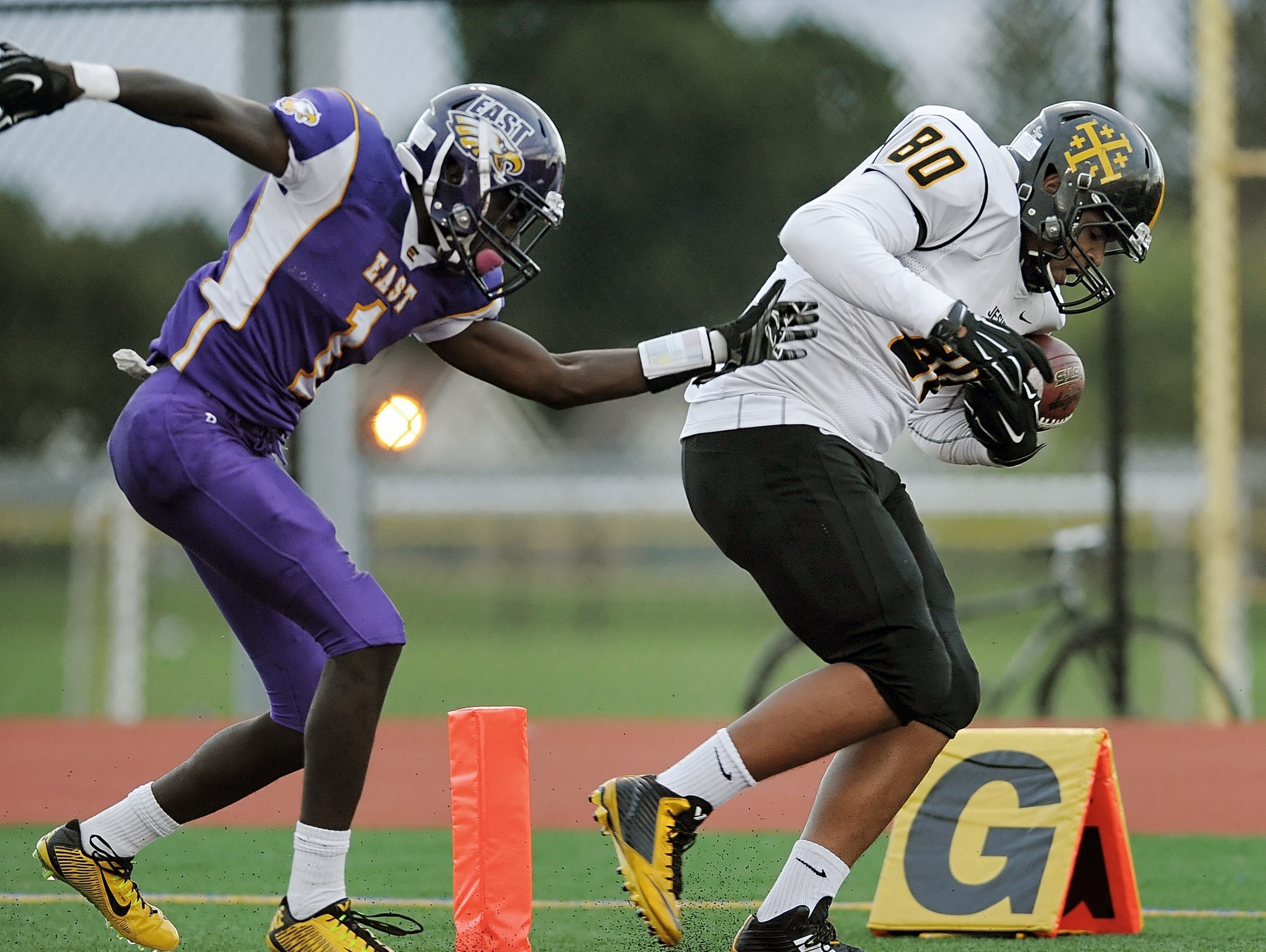 McQuaid's Demetrius Breedlove, right, was named the 2014 Rochester City Athletic Conference Player of the Year.