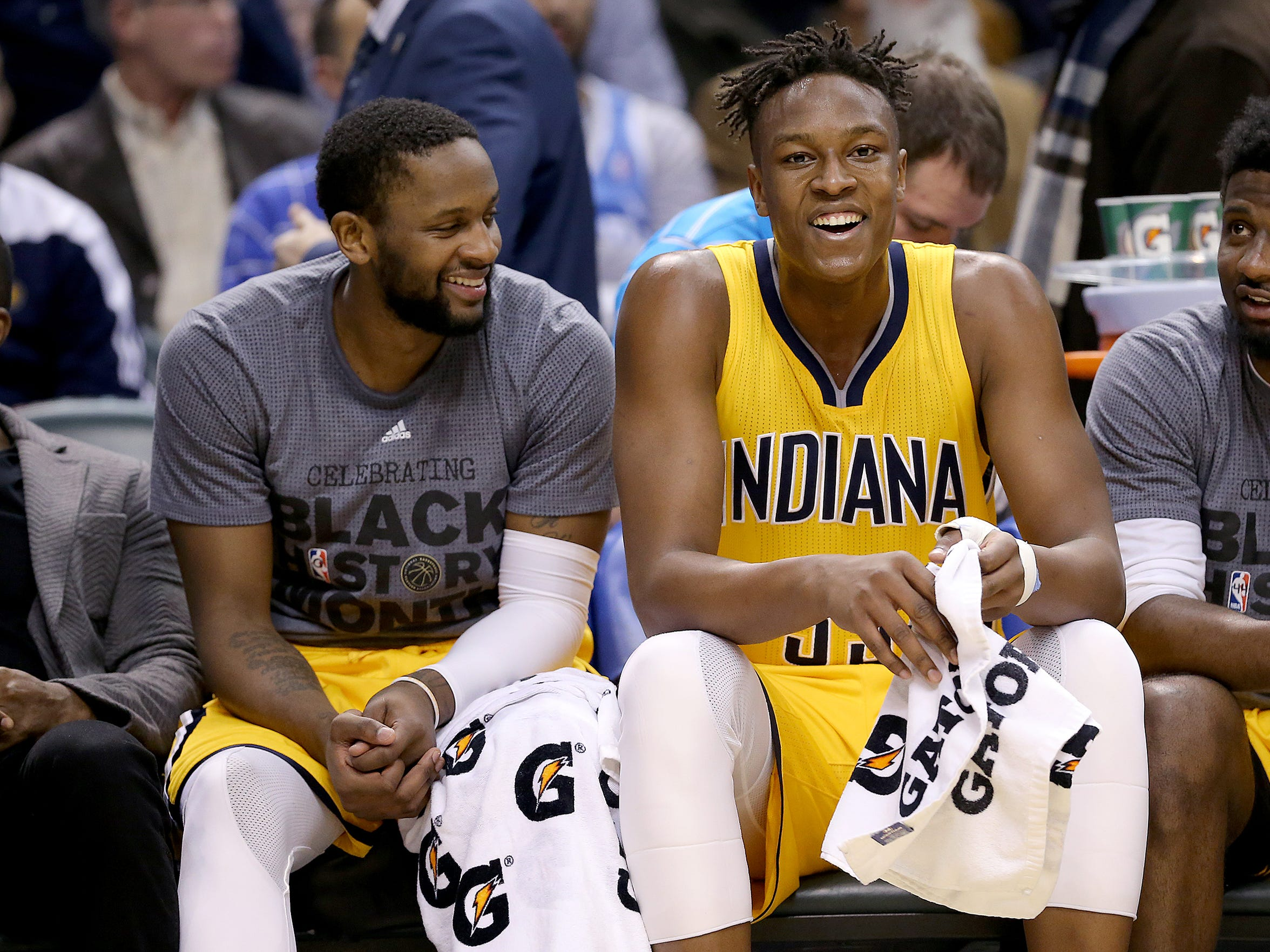 Indiana Pacers forward C.J. Miles (0),left, and Myles Turner (33) share a laugh Feb8, 2016 at Bankers Life Fieldhouse.