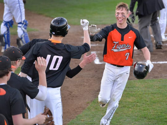 St. Cloud Tech's Justin Mohs (7) celebrates scoring the second run in the game against St. Cloud Apollo in the second inning Friday night, April 22 at Dick Putz Field.