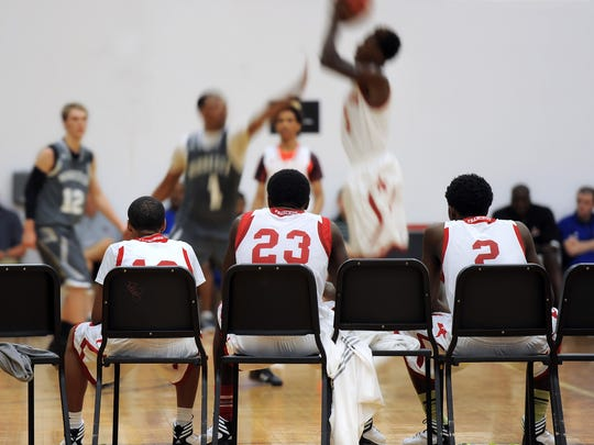Members of the Houston Franchize team watch game action from the bench during the AAU adidas Invitational held at North Central High School and other various locations throughout Indianapolis. July 11, 2013.