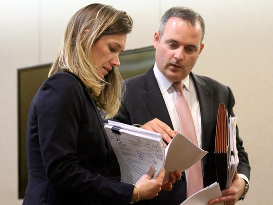 Monmouth County Assistant Prosecutors Megan Doyle and Chris Decker confer during a pre-trial hearing for Liam McAtasney in Superior Court Judge Richard English's courtroom in Freehold, NJ, Tuesday, January 9, 2018.  McAtasney is charged, along with Preston Taylor, in the death of Sarah Stern.
