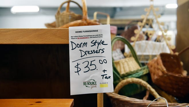 A price tag advertises a dresser as appropriate for a dorm, as seen at Re-Source York's home goods store Friday, July 15, 2016, in York. The store is beginning a partnership with York College to help students purchase and, later, sell used furniture for their dorms or apartments.