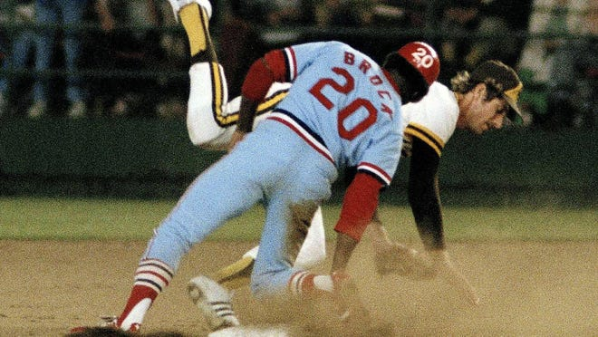 St. Louis Cardinals' Lou Brock steals second base standing up on Aug. 30, 1977, breaking Ty Cobb's major league record of 892 stolen bases.