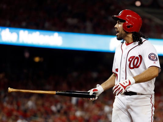 Washington Nationals' Anthony Rendon argues with home plate umpire Cory Blaser after a called third strike during the eighth inning in Game 1 of baseball's National League Division Series against the Chicago Cubs, at Nationals Park, Friday, Oct. 6, 2017, in Washington. (AP Photo/Alex Brandon)