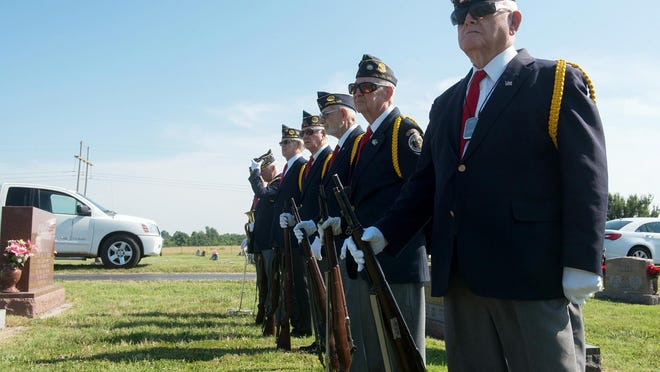 Members of the Robert Thurman American Legion Post honor guard wait for the beginning of a funeral at the Diamond Cemetery in Diamond.