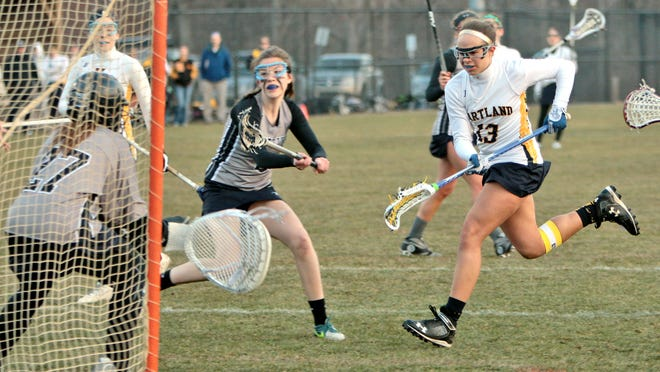 Hartland's Danielle Porath recorded a hat trick in the Eagles' 14-7 victory over South Lyon Unified on Wednesday.
