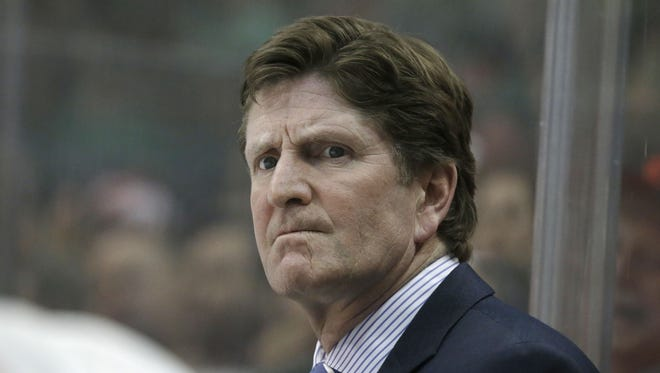 Detroit Red Wings head coach Mike Babcock watches from the bench during the first period of an NHL hockey game against the Dallas Stars Saturday, Feb. 21, 2015, in Dallas.