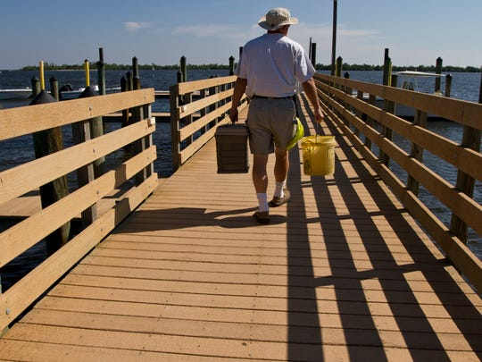 A visitor to Cayo Costa State Park makes his way down the main docks as he readies to depart the island.