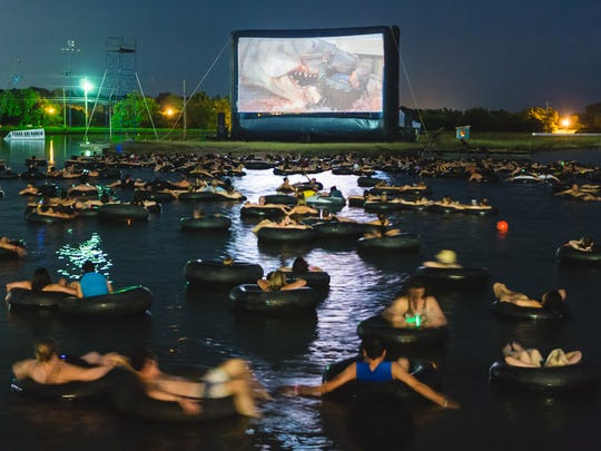 Moviegoers watch 'Jaws' while floating on inner tubes on a man-made lake outside of Austin during a June screening by the Alamo Drafthouse.