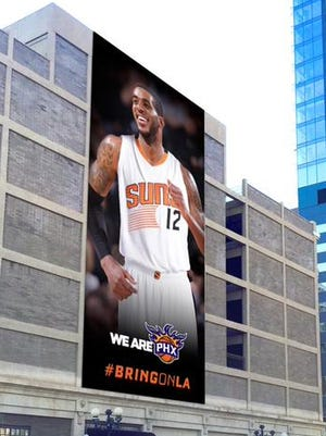 The Suns and city of Phoenix planned to hang a LaMarcus Aldridge banner in downtown Phoenix in July but this photo-shopped image was as far as they got before Aldridge picked San Antonio in free agency.