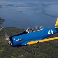 Alan Anders, Jeff Geer, Mark Kandianis and Elizabeth Ackley were in Great Falls in June with a vintage T-6 Texan. They are recreating the Lend-Lease route that sent American made planes to the Russians during World War II.