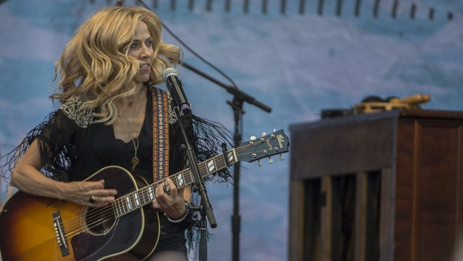 In this file photo, Sheryl Crow performs at the Pilgrimage Music & Cultural Festival at the Park at Harlinsdale on Saturday Sept. 26, 2015, in Franklin in Tenn.
