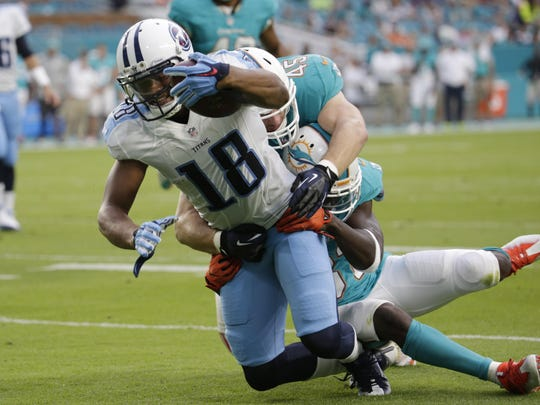 Miami Dolphins free safety Michael Thomas (31) and linebacker Mike Hull (45) tackles Tennessee Titans wide receiver Rishard Matthews (18) during the first half of an NFL preseason football game, Thursday, Sept. 1, 2016 in Miami Gardens, Fla. (AP Photo/Lynne Sladky)