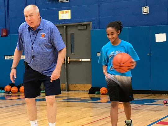 Jack Hogan, left, instructs a young girl at the 35th