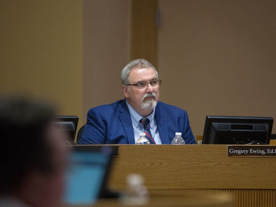 Greg Ewing, superintended at Las Cruces Public Schools, listens to a budget update presentation by Ed Ellison LCPS chief financial officer, Tuesday April 17, 2018 at the school board meeting at LCPS Central office.
