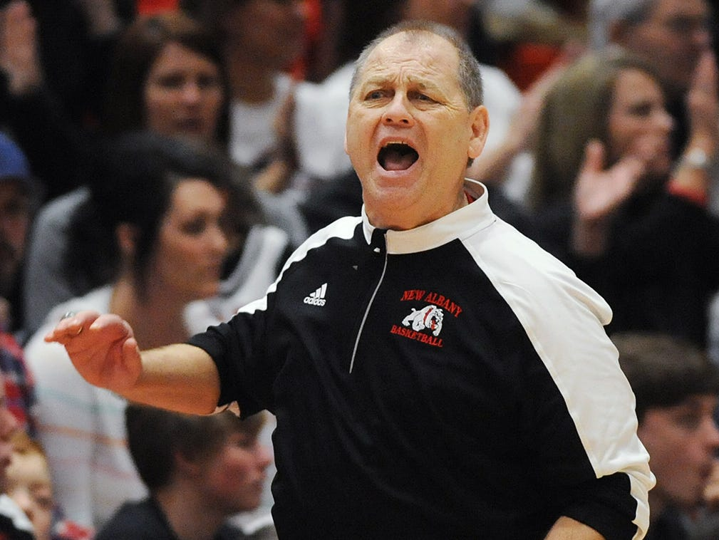 New Albany head coach Jim Shannon yells instruction at his Bulldogs as they take on Providence on Friday at New Albany High School. New Albany won 55-40.