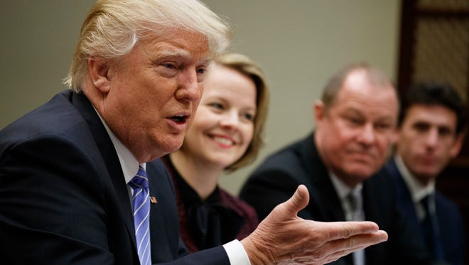 President Donald Trump speaks during a meeting with retail industry leaders in the Roosevelt Room of the White House in Washington, Wednesday, Feb. 15, 2017. From left are, Trump, Jo-Ann Craft Stores CEO Jill Soltau, Gap Inc. CEO Art Peck and Jeremy Katz, an adviser to National Economic Council director Gary Cohn. (AP Photo/Evan Vucci)
