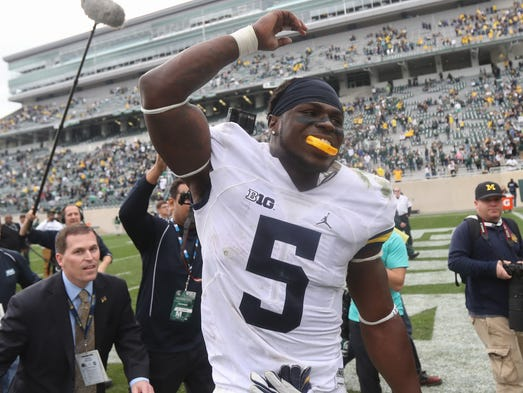Michigan linebacker Jabrill Peppers celebrates the