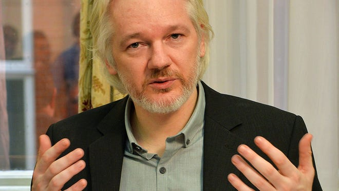 This file photo taken on August 18, 2014 shows WikiLeaks founder Julian Assange gesturing during a press conference on August 18, 2014 inside the Ecuadorian Embassy in London where Assange has been holed up for two years.