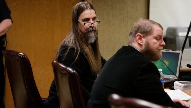 Brian T. Flatoff, left, sits with public defender Ben Szilagyi during the attempted homicide and felony murder trial in Winnebago County Circuit Court. Szilagyi had been present as a court-ordered standby counsel. On Thursday, the judge ordered him to begin serving as Flatoff's attorney for the remainder of the trial.