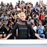 Actress Charlize Theron poses for photographers during a photo call for the film Mad Max: Fury Road, at the 68th international film festival, Cannes, southern France, Thursday, May 14, 2015.
