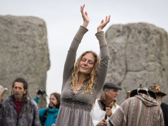 A woman dancing during the Autumn Equinox Celebration in