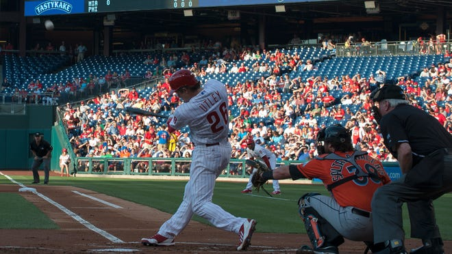 Philadelphia Phillies Chase Utley hits a two-run home run in the 14th inning to win the game against the Miami Marlins at Citizens Bank Park.