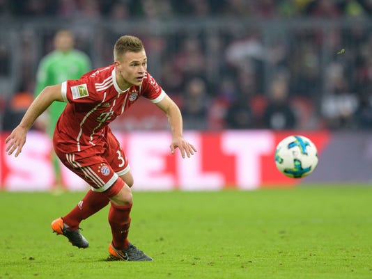 FILE 0 In this Feb. 10, 2018 file photo Bayern's Joshua Kammich follows the ball in a Bundesliga match against Schalke in Munich, southern Germany. Germany midfielder Joshua Kimmich has extended his contract with Bayern Munich by three years through June 2023. (Matthias Balk/dpa via AP)
