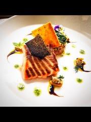 A salmon dish prepared by Logan Parker.
