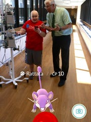 A screenshot through the lens of the game featuring Kyle Wood and Dr. David Margolis playing Pokemon Go at Children's Hospital in Milwaukee.