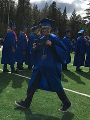 Despite several health obstacles, Bailey Johnson graduated with the rest of his class at South Tahoe High School at age 18.