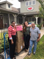 Workers at Small Steps Nurturing Center in Texas accept Pederson's donated items, collected by his family and neighbors, middle school students and others.