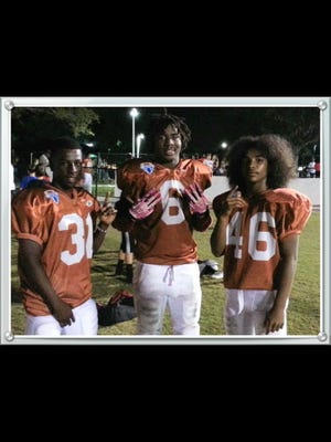 Fred Green, Abraham Alce and Malcom Jackson as eighth-grade Pop Warner stars.