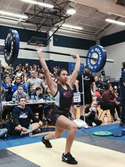 Vero Beach's Jayda Jenkins finishes a clean and jerk in the 119-pound division of the Class 2A girls weightlifting state meet in 2018. Jenkins is one of 10 Vero Beach weightlifters who has qualified for the state meet this season.