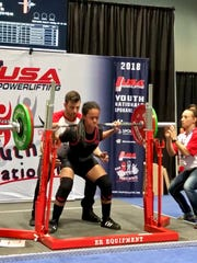 Diana Yturbe competes in the 2018 USA Powerlifting Youth National Championships in Spokane, Wash.