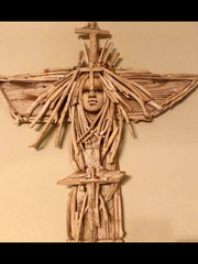 Wesley Walberg made crosses out of driftwood he found
