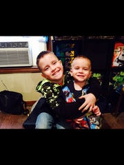 Chason Cambers, left, hugs his brother Colt Cambers, right. Colt Chambers was two years old when  he was bitten by a rattlesnake in his yard on Dec. 17, 2016.