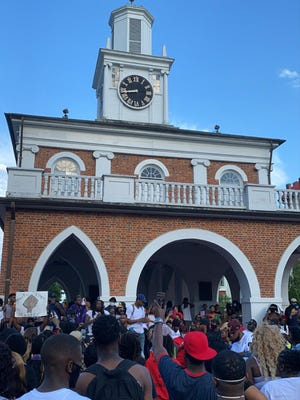 Protesters gather at the Market House on May 30. Later that night, windows were broken and the Market House was set on fire. Businesses say a delayed response by police has hurt the downtown image and chased customers away.