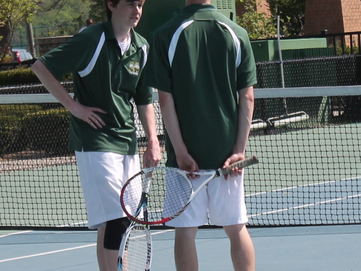 Kyle Cullion and Steven Sinclair of McNicholas discuss strategy before their doubles match at Lunken Playfield May 6 last year.