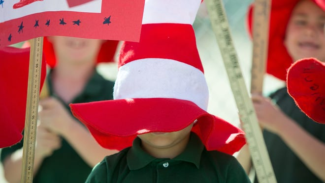 The large brim of a Dr. Seuss themed hat covers the face of J. Paul Taylor Academy student Isaiah Parra, 8, on Wednesday, March 2, 2016, as he and his classmates take a walk around the Alameda neighborhood.