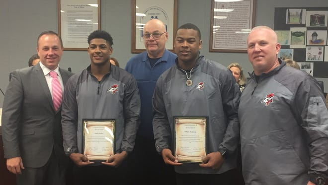 Vineland High School football standouts, Isaih Pacheco (left) and Nihym Anderson, were honored at the Jan. 10 school board meeting before the duo head off to their Big 10 college campuses. Also pictured, BOE president Jeff Bordley ( left), board member Eugene Medio (center) and VHS football coach Dan Russo (right.)