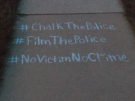 Messages written in chalk by Kyle Gerding, a Fremont man who is protesting local law enforcement agencies.