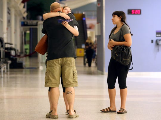 Lewis Thorp hugs his daughter Lelia Thorp as her she and her friend Sarah Stanford prepare to flight out of Corpus Christi as Hurricane Harvey approaches the Gulf Coast area on Friday, Aug. 25, 2017, at the Corpus Christi International Airport in Corpus Christi.