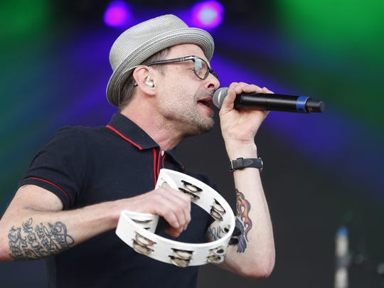 Gin Blossoms lead singer Robin Wilson performs with