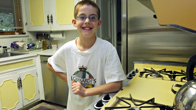 Michael Lombardi, 11, poses in his grandmother's kitchen July 15, 2014. He entered a recipe contest sponsored by Michelle Obama and won, and is traveling this weekend to the White House.