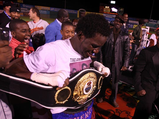 Fernando Guerrero celebrates with the N.A.B.O. Title belt after he beat Ossie Duran in ten rounds at Arthur W. Perdue Stadium in 2009. It was Guerrero's first title win.