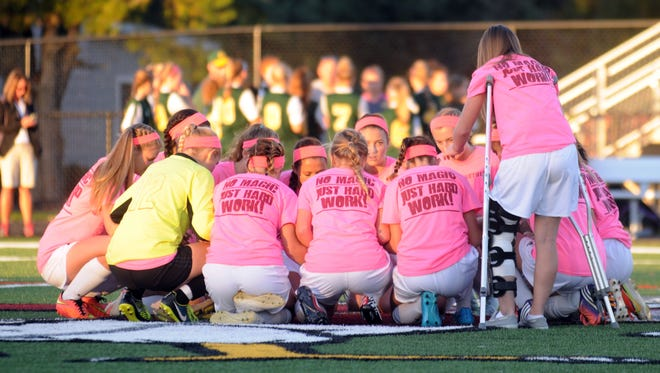 The Snow Hill girls soccer team gets together before its final game of the season.
