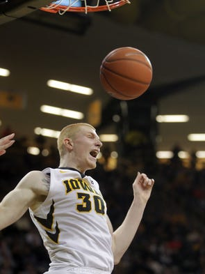 Iowa's Aaron White dunks the ball during the Hawkeyes'