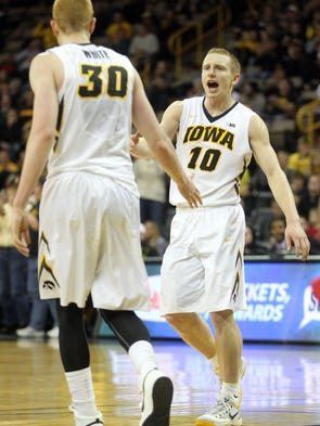 Iowa's Mike Gesell (10) high-fives Aaron White during