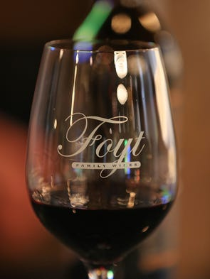 A glass of wine, at the Foyt Wine Vault, in Speedway,